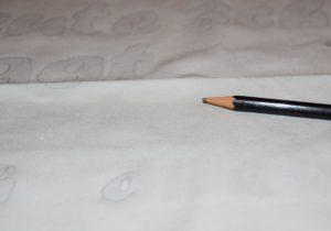 Text mit Bleistift vorschreiben